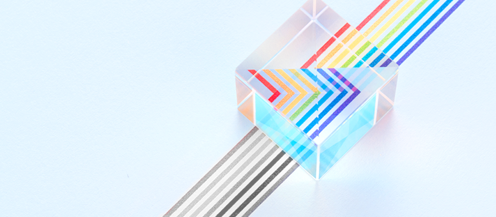 prism showing colored lines from grey